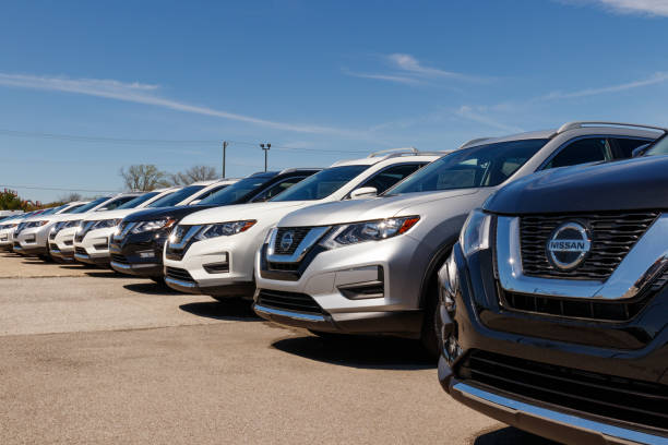 New vehicles at a Nissan Car and SUV Dealership. Nissan is part of the Renault Nissan Alliance IV stock photo