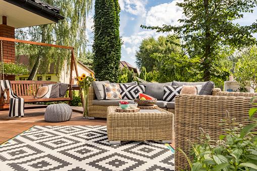 New design villa patio with comfortable rattan furniture and pattern carpet