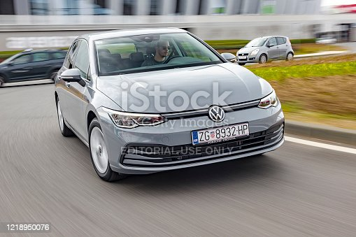 Zagreb, Croatia - March 9, 2020: Man is driving new Volkswagen Golf fast in a roundabout. The 8th generation of iconic VW model is based on updated version of the MQB platform.