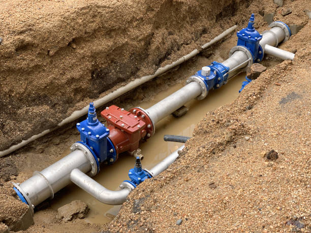 new water pipe in the ground image of new water pipe in the ground sewer stock pictures, royalty-free photos & images