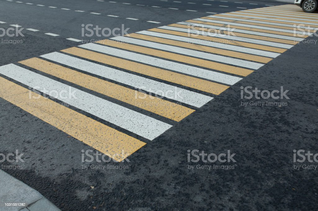 new white and yellow pedestrian bacground in the city stock photo