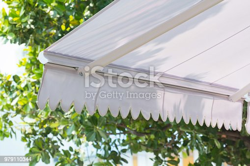 new white awning of coffee shop in garden background
