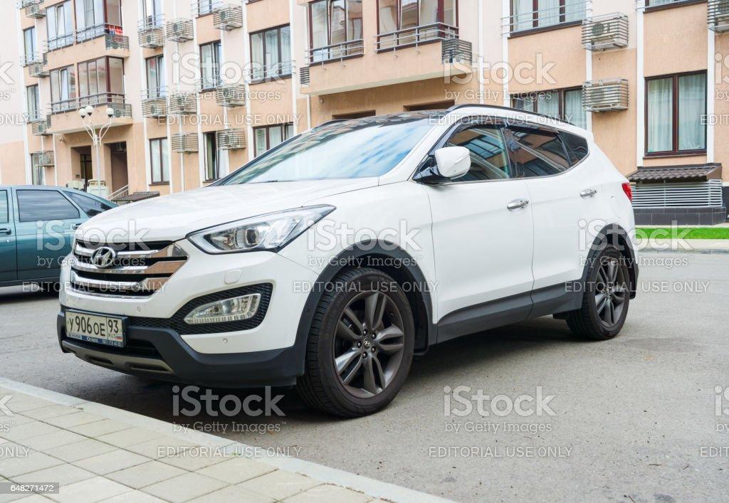 Sochi, Russia - October 11, 2016: New white Hyundai Santa Fe parked on the street near the house. stock photo