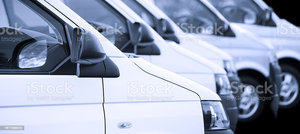 New white vans in a row on black royalty-free stock photo