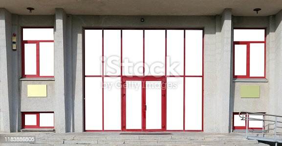 178842131 istock photo New  windows and doors of a modern big office building panoramic outdoor shot 1183886805