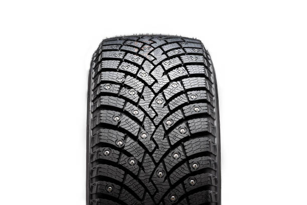 New winter studded tire, safety and premium quality. black background, close-up isolated new winter studded tire, safety and premium quality. novelty studded stock pictures, royalty-free photos & images