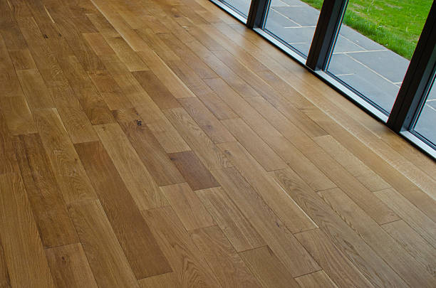 new wood floor in home stock photo