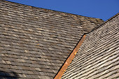 istock new wood shingle roof with copper gutter 1168227262