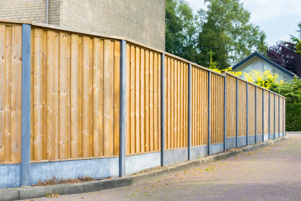 New wooden fence along the street stock photo