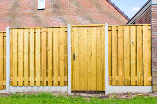 New wooden fence construction with door stock photo