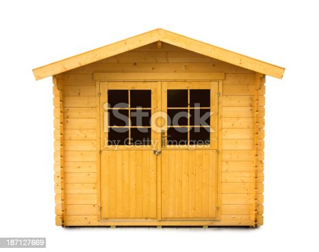Close up of a new wooden garden shed on white background