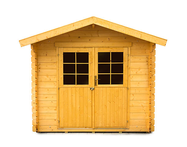 new Wooden Garden Shed isolated on white Close up of a new wooden garden shed on white background shed stock pictures, royalty-free photos & images