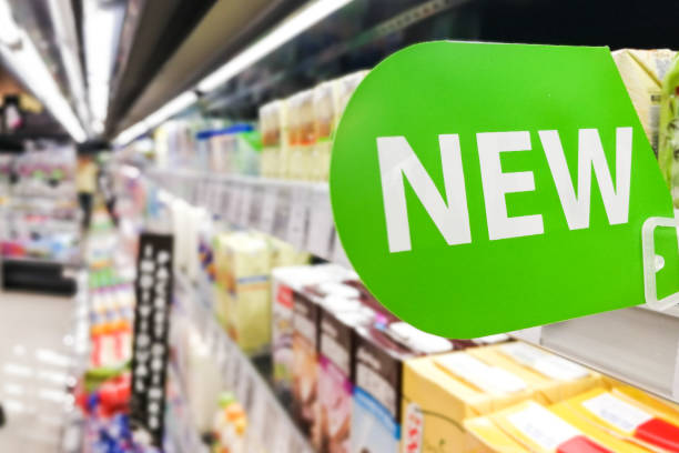 New word signage on supermarket shelf for new product arrival stock photo