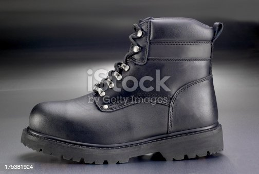 New black work boot on greay background