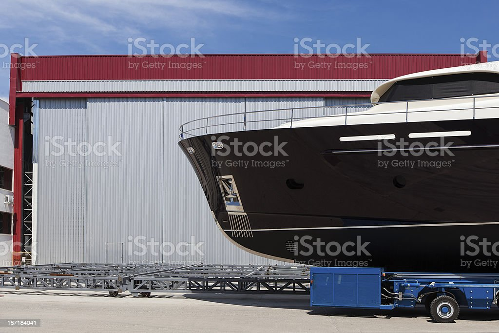 New yacht transporting on the asphalt royalty-free stock photo