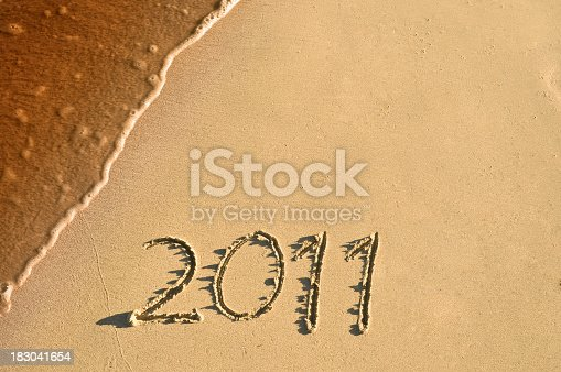 istock New Year 2011 sign at  a Tropical beach 183041654