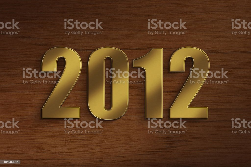 New Year - 2012 Metallic / gold colored numbers (2012 - new year) on wooden background. 2012 Stock Photo