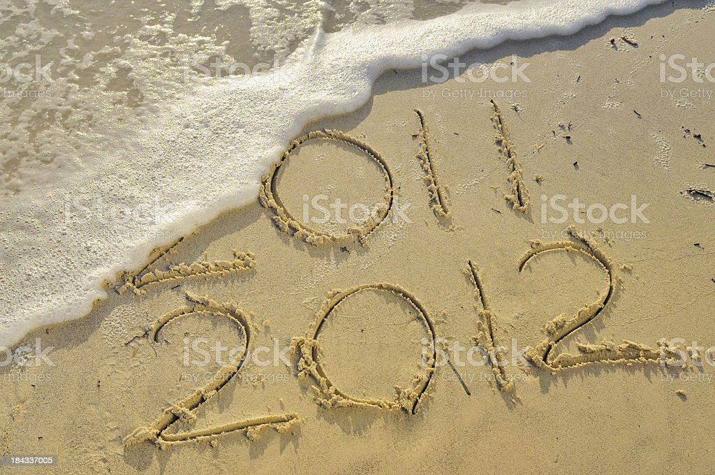 New Year 2012 Written in the Sand W Wave royalty-free stock photo
