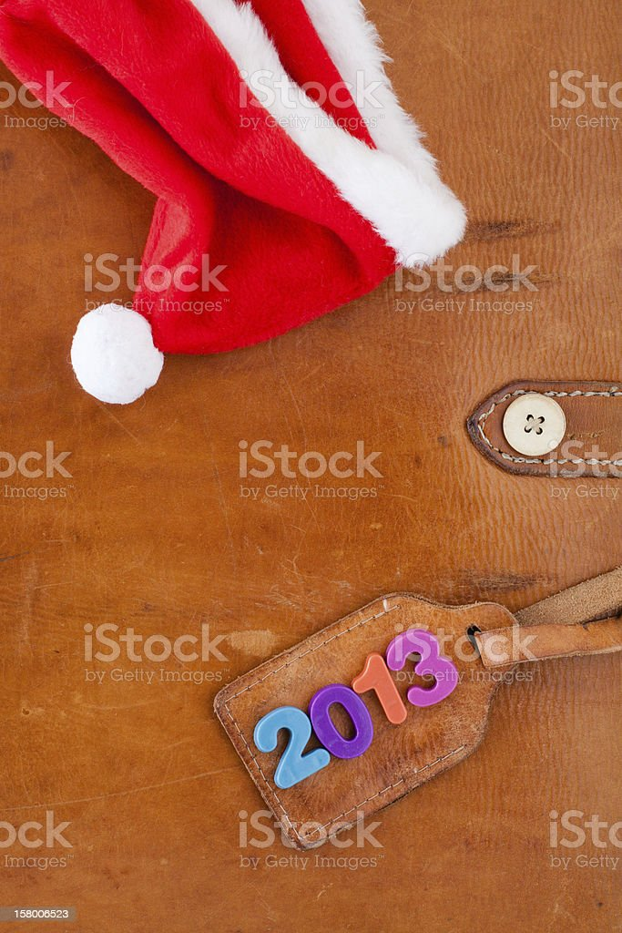 New Year 2013 date, Santa cap on vintage leather background royalty-free stock photo