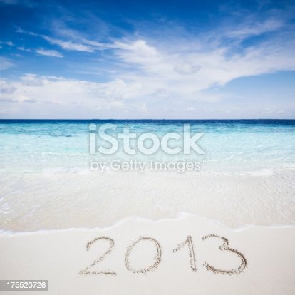 Handwritten 2013 message in smooth sand on tropical beach