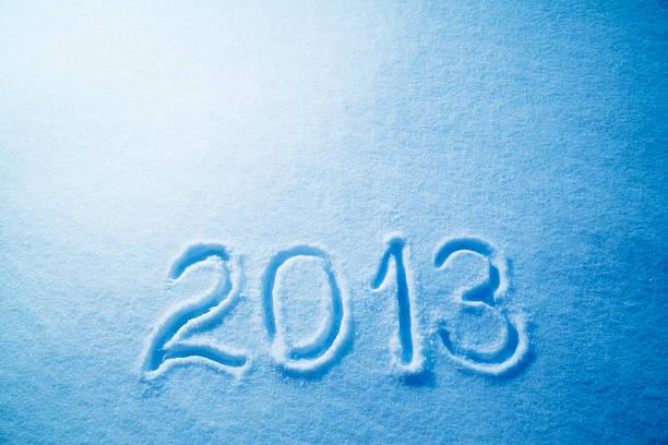 silvester 2013 - es schneit text stock-fotos und bilder