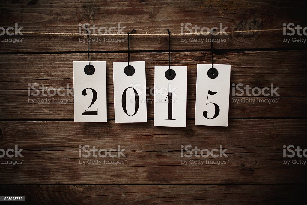 New Year 2015 hanging tags stock photo