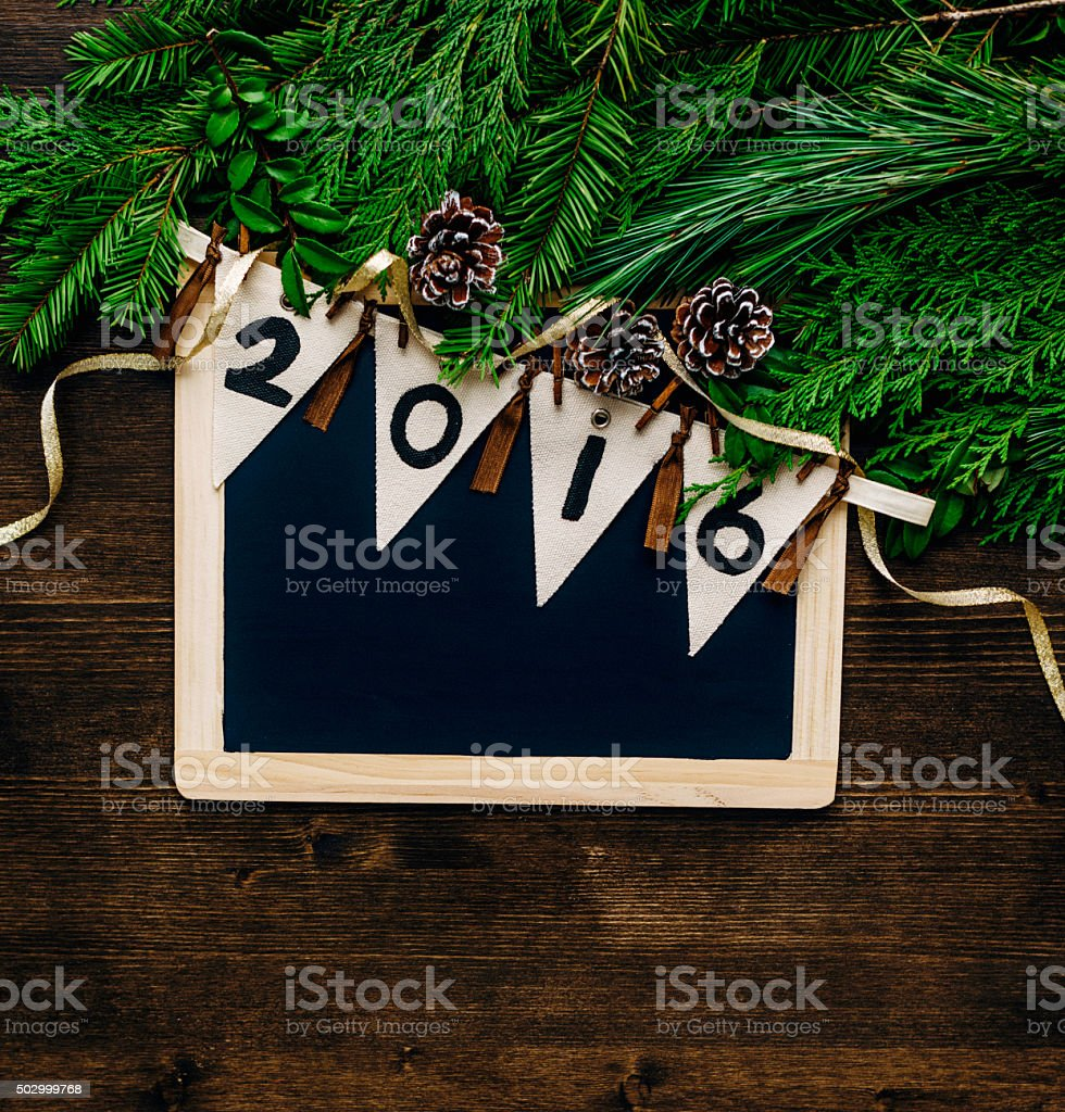 New Years Foliage >> New Year 2016 Banner On Chalkboard With Assorted Christmas Foliage