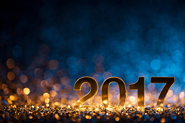 New Year 2017 - Christmas Decoration Gold Blue Party Celebration Golden numbers 2017 on glitter and defocused lights. 2017 stock pictures, royalty-free photos & images