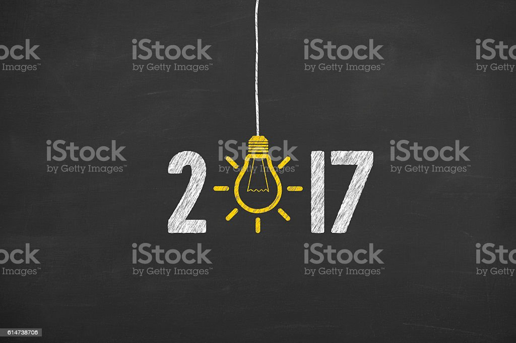 New Year 2017 Idea Concept on Chalkboard Background stock photo