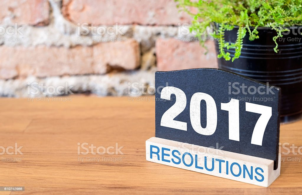 New year 2017 number on blackboard sign and green plant stock photo