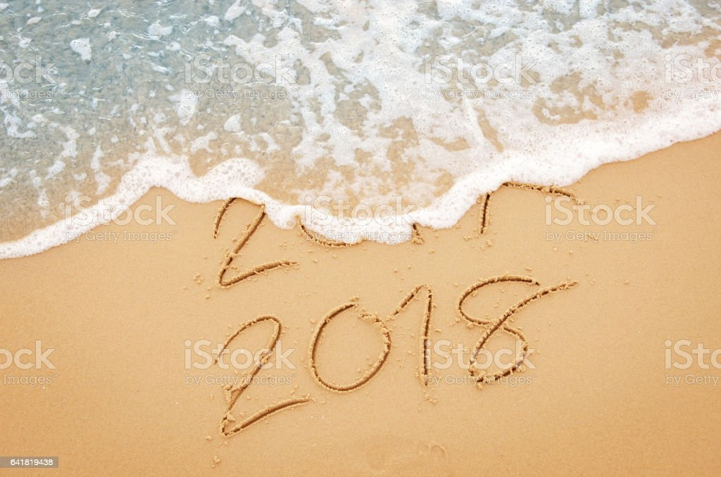 New Year 2017 replace 2016 on sea beach summer stock photo
