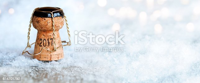 istock New Year 2017 with a champagne cork 614701792