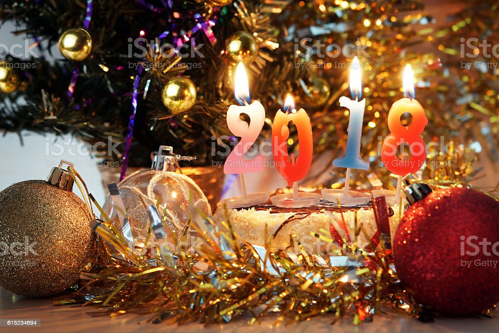 New Year 2018 composition. Holiday decorations and burning candles stock photo