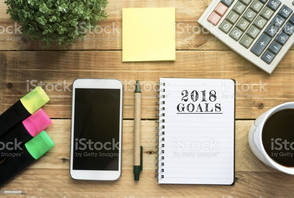 New Year 2018 Goals list written on a notepad stock photo