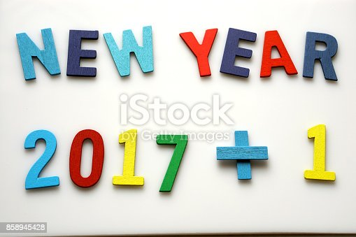 istock New year 2018 made from Multicolored Alphabet letters  are lined on White background with empty space. Education or business concept. 858945428