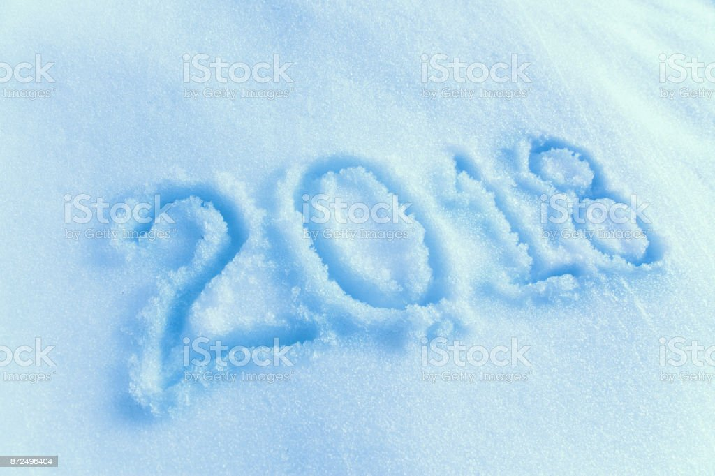 New year 2018 text on the snow stock photo