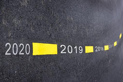 619522908 istock photo New year 2018 to 2020 1020001040