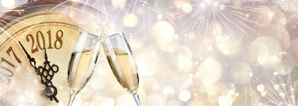 New Year 2018 - Toast With Champagne And Clock stock photo