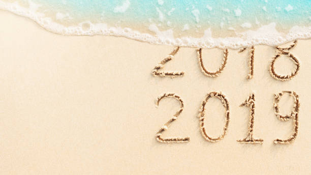New Year 2019, beach background stock photo