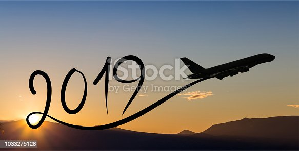 istock New year 2019 by flying airplane on the air at sunrise 1033275126