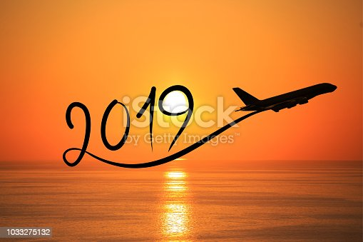 istock New year 2019 by flying airplane on the air at sunrise 1033275132