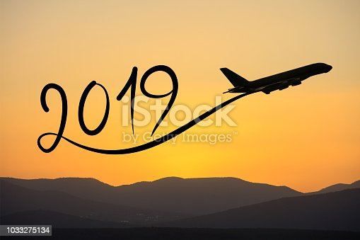 istock New year 2019 by flying airplane on the air at sunrise 1033275134