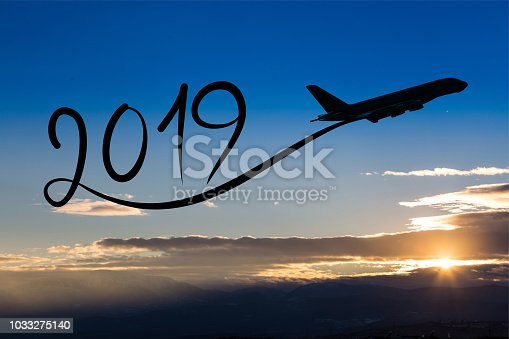 istock New year 2019 by flying airplane on the air at sunrise 1033275140