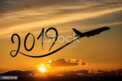 istock New year 2019 by flying airplane on the air at sunrise 1033275148