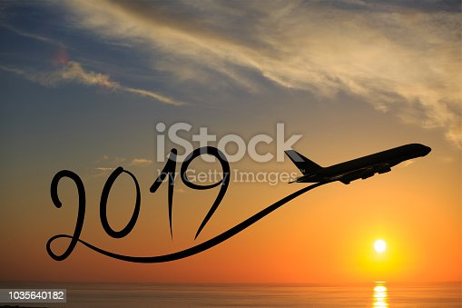istock New year 2019 by flying airplane on the air at sunrise 1035640182