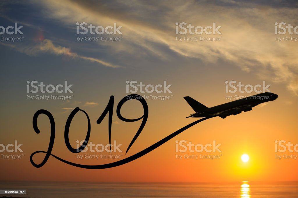 New year 2019 by flying airplane on the air at sunrise stock photo