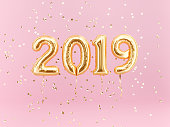 New year 2019 celebration. Gold foil balloons numeral 2019 and confetti
