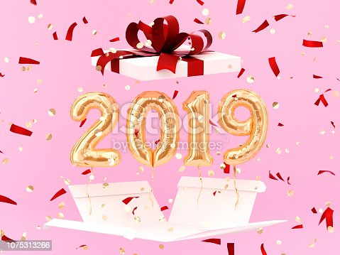 istock New year 2019 celebration. Gold foil balloons numeral 2019 1075313266