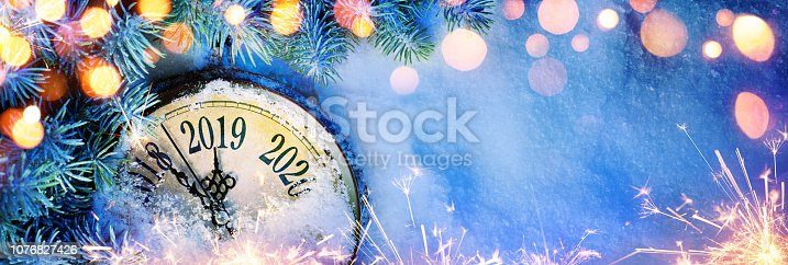 istock New Year 2019 - Celebration With Dial Clock On Snow And Lights 1076827426