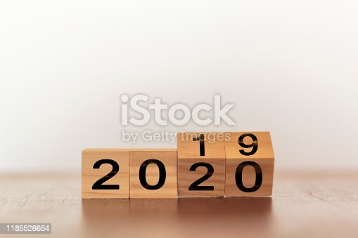 1066508880istockphoto New year 2019 change to 2020. Wooden cubes with copy space 1185526654